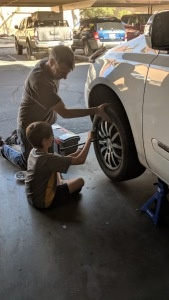 father-son-changing-brakes